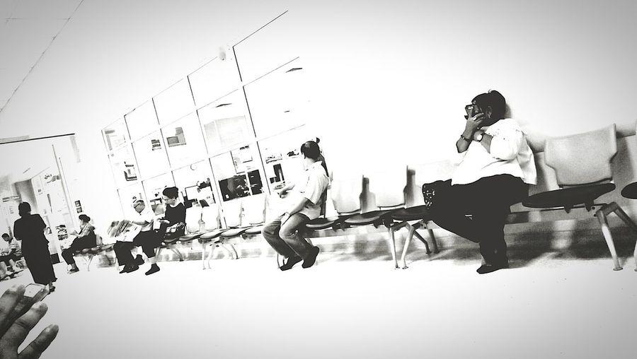 People sitting against sky