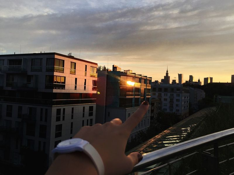 Bilding Cityscape Time For Nature Human Hand Architecture Sky Building Exterior Built Structure Real People Cloud - Sky Outdoors Sunset Nature Day Lifestyles Human Finger Mobility In Mega Cities Stories From The City Go Higher
