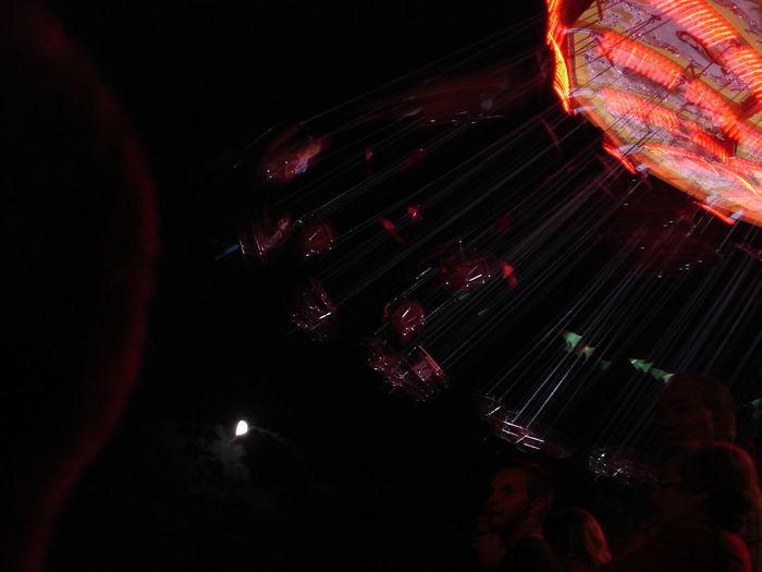 Amusement Park Black Background Illuminated Indoors  Night Nightlife One Person People Fun Full Moon Full Moon Night  Swing Swinging Karussell Flying Feels Like Love