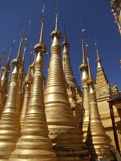 Modern Stupas Blue Sky Buddhism Buddhist Architecture Buddhist Stupas Composition Full Frame Gold Coloured Inle Lake Kakku Low Angle View Myanmar No People Outdoor Photography Pilgrimage Place Of Prayer Place Of Worship Religion Shan State Side By Side Stupas Sunlight And Shadows Tourism Tourist Attraction  Tourist Destination Unusual