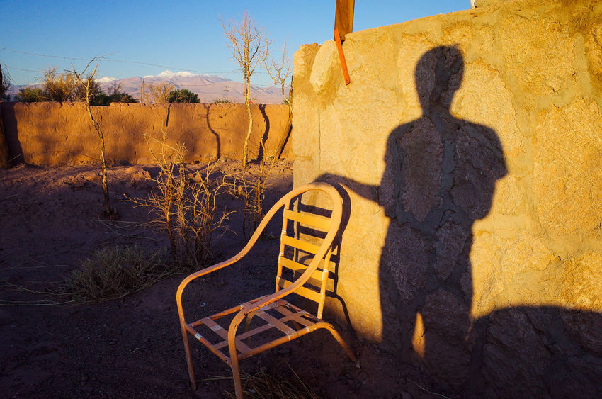 San Pedro de Atacama, 2018 The Traveler - 2018 EyeEm Awards Communication Day Land Landscape Lifestyles Men Nature One Person Outdoors Plant Real People Rear View Shadow Sky Standing Sunlight Text Tree Yellow