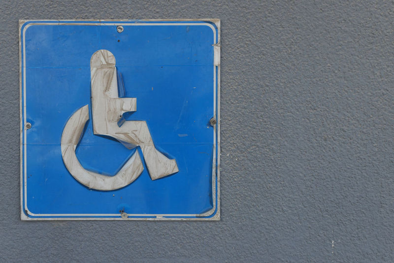 Close-up of blue sign on wall