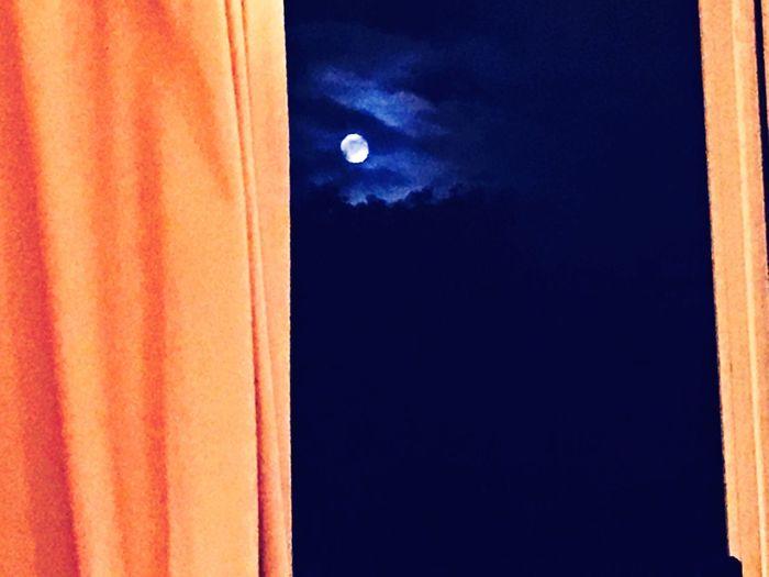 Full moon peeks