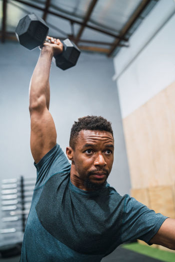 Male athlete exercising in gym