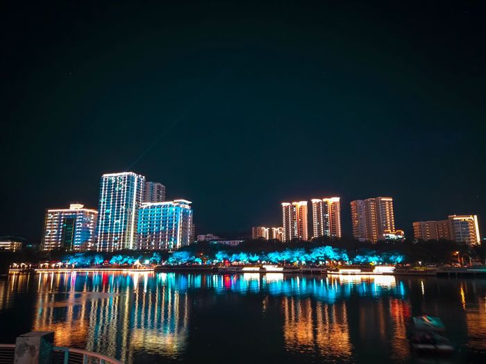 Night Illuminated Building Exterior Architecture Built Structure City Water Outdoors Skyscraper Nature Urban Skyline Modern No People Office Building Exterior Waterfront Sky Building Reflection Cityscape Tall - High
