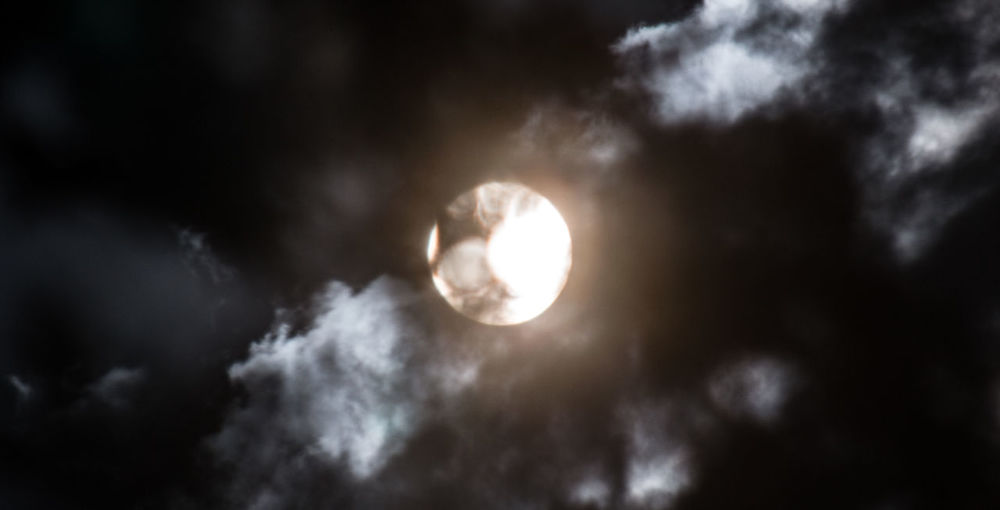 Sun photographed through tree leaves and clouds. Astronomy Backgrounds Cloud - Sky Clouds Low Angle View Outdoors Shadows Sky Sun