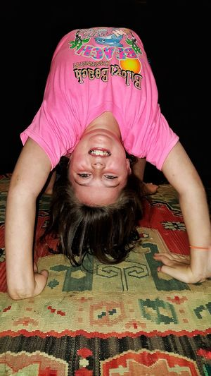 Pink Color One Person Only Women Front View People Portrait One Woman Only Adult Adults Only Happiness One Young Woman Only Smiling Black Background Indoors  Young Adult Day Close-up Backbend Upside Down Gymnastics Flexability Flexible Playing Childhood