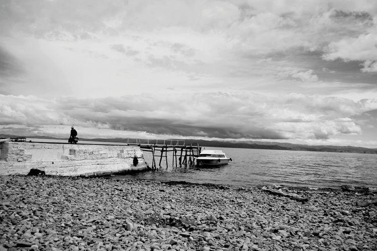 Landscape Travel Blackandwhite Lake Monochrome Light And Shadow Man Water Beach Full Length Sand Silhouette Sky Boat