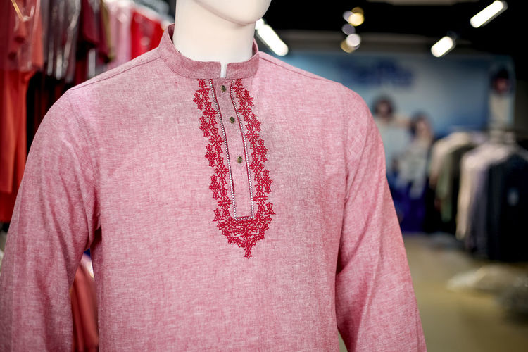 Close-up of pink kurta on mannequin in store