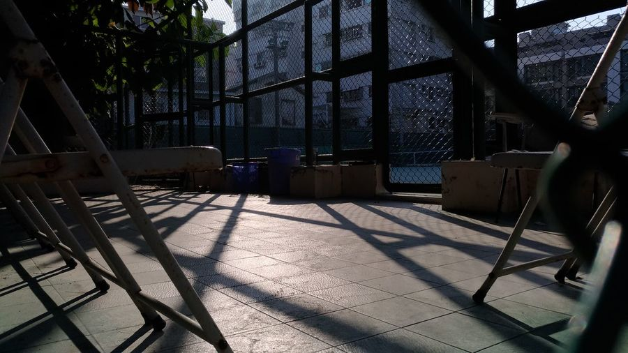 Sunshine and shadow Outdoors EyeEmNewHere EyeEm Best Shots Eye4photography  EyeEm ready Eyeemphotography Eyeemtaiwan Chair Streetphotography Shadow Sunlight Winter Cold Temperature Window Day Architecture Tree No People