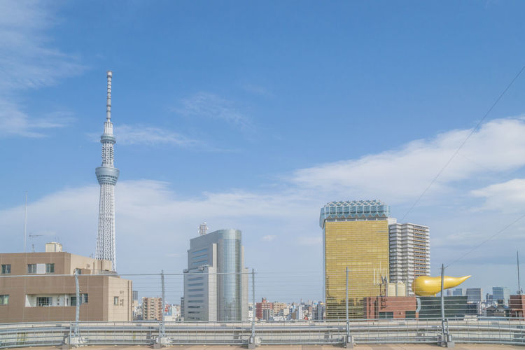 Tokyo Sky Tree and Asahi Super Dry Hall Architecture Built Structure Building Exterior Sky Building City Tower Tall - High Office Building Exterior Travel Nature Travel Destinations Skyscraper Day Cloud - Sky Tourism No People Outdoors Modern Spire  Cityscape Global Communications Tokyo Sky Tree Asahi Super Dry Hall