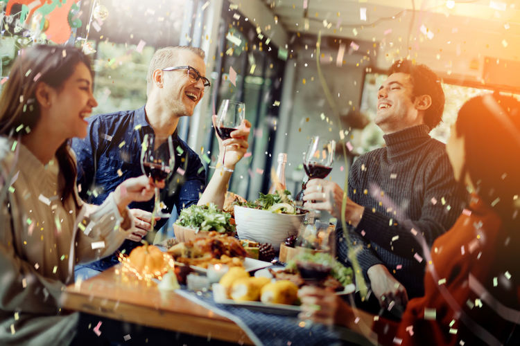 happiness friends christmas eve celebrate dinner party with food wine and laugh together with joyful moment Food And Drink Drink Group Of People Smiling Happiness Celebration Togetherness Refreshment Alcohol Adult Women Lifestyles Friendship Fun Event Young Adult Enjoyment Emotion Cheerful Social Gathering Drinking Glass Community Positive Emotion Celebratory Toast