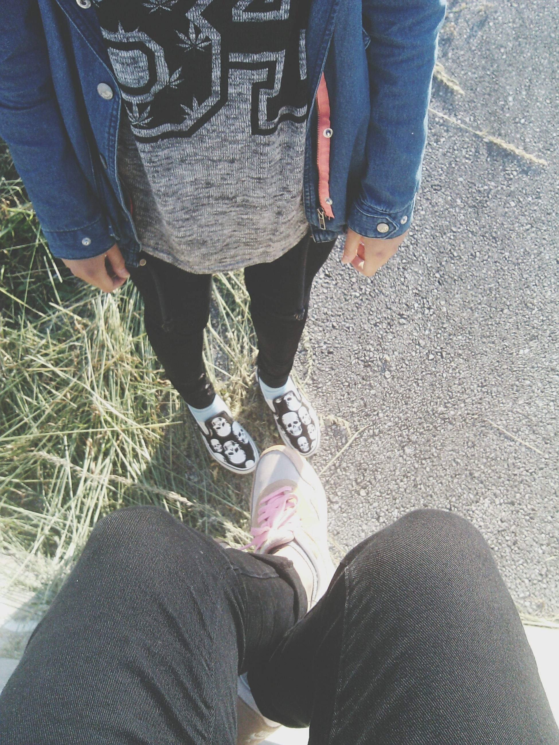 low section, lifestyles, person, men, shoe, casual clothing, jeans, leisure activity, standing, togetherness, bonding, friendship, footwear, high angle view, human foot, street, walking