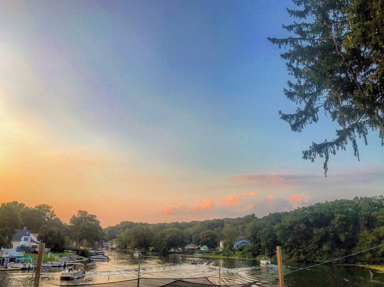 tree, beauty in nature, scenics, nature, sky, tranquil scene, tranquility, water, river, outdoors, no people, sunset, cloud - sky, nautical vessel, landscape, day