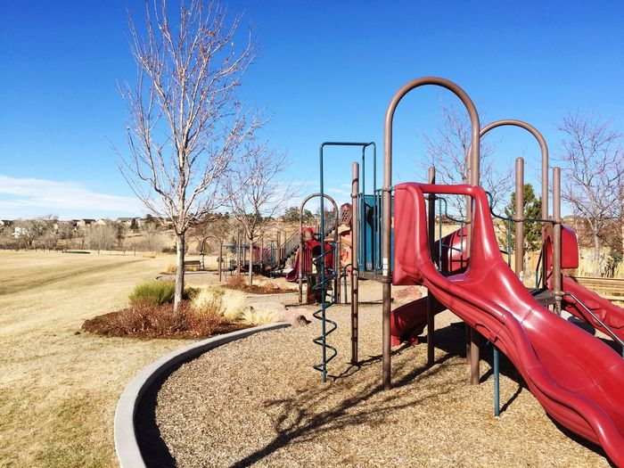 Open space park Parker Colorado suburban suburbs suburbia winter daytime snowless playground