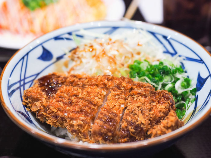 Close-Up Of Crispy Fried Meat With Rice Served In Bowl On Table