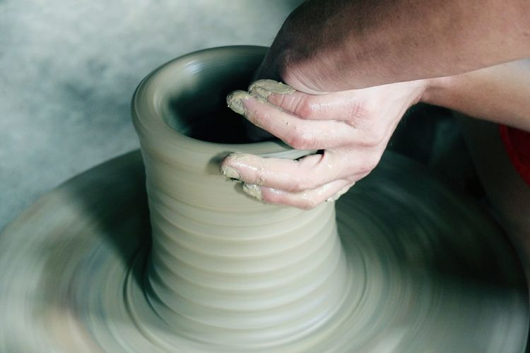 Cropped Hand Of Craftsperson Making Pot