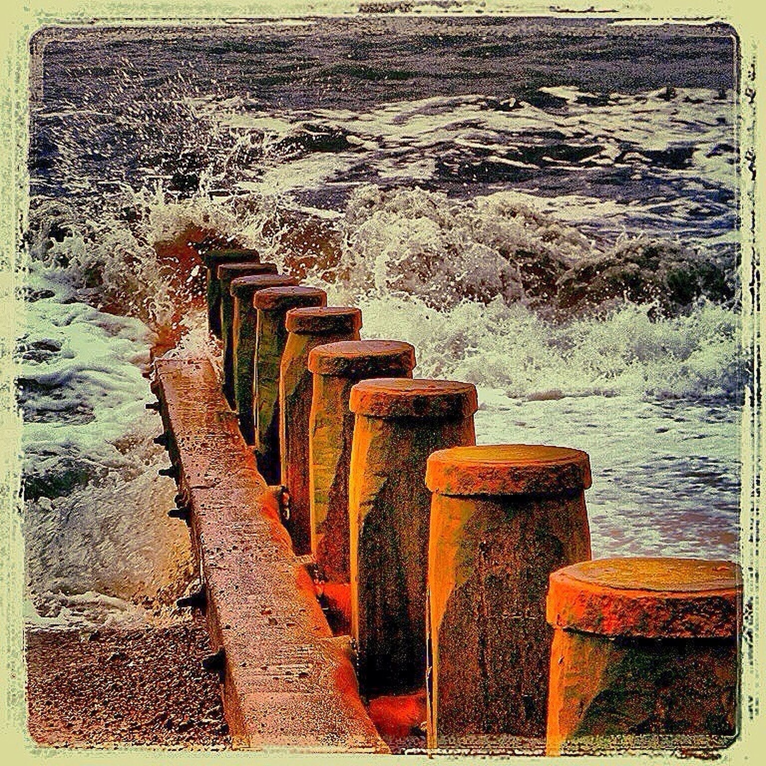 transfer print, wood - material, auto post production filter, in a row, wooden, large group of objects, stack, railing, water, wood, day, steps, outdoors, arrangement, no people, high angle view, repetition, pattern, abundance, pier