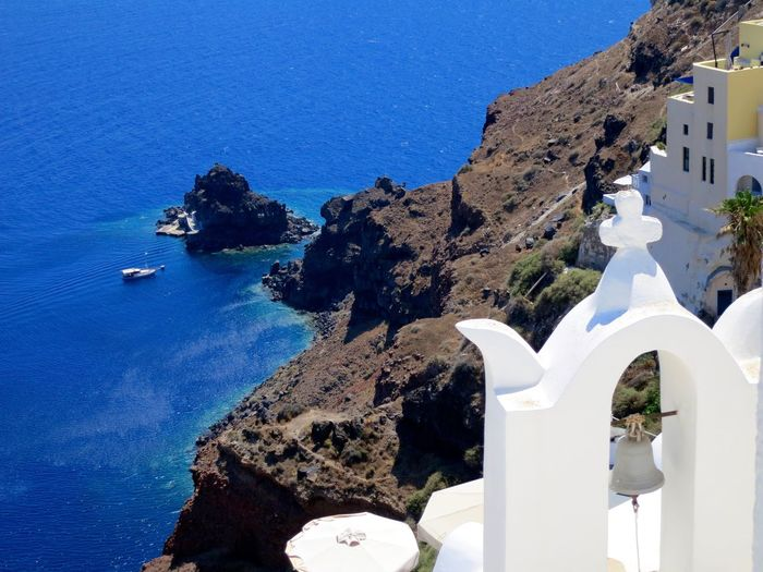 High angle view of bell tower at santorini against aegean sea