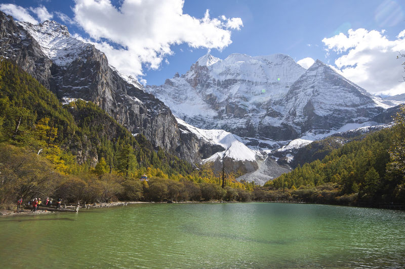 Mountain Water Scenics - Nature Beauty In Nature Mountain Range Lake Sky Cloud - Sky Non-urban Scene Tranquil Scene Waterfront Snow Nature Tranquility Winter Idyllic Day Cold Temperature Snowcapped Mountain Outdoors No People Formation Mountain Peak Yading China