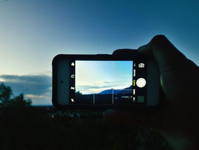 Photography Themes Photographing Camera - Photographic Equipment Photo Messaging Smart Phone Portable Information Device Device Screen Technology Mobile Phone Wireless Technology Only Men Adults Only Communication Holding Human Body Part Selfie Filming One Man Only Human Hand People