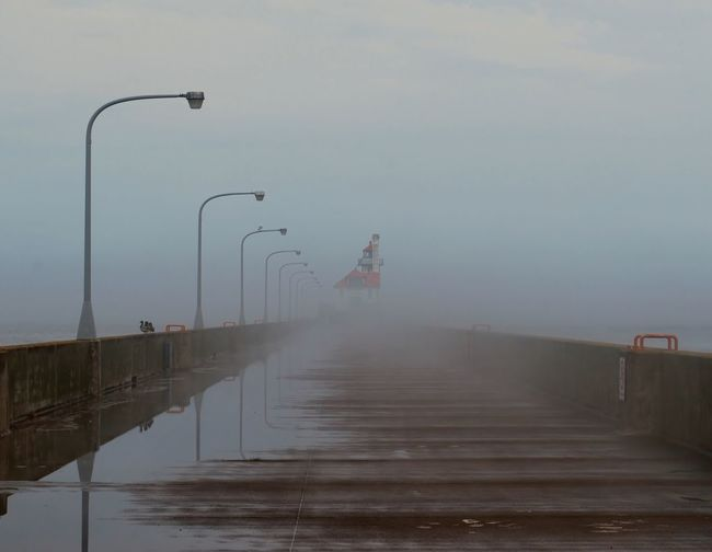 Beauty In Nature Day Fog Full Length Lighthouse Lighthouse In Fog Lighthouse In The Distance Men Nature Outdoors People Real People Scenics Sea Sky Water