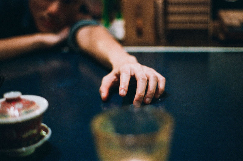 Close-up of hand on table