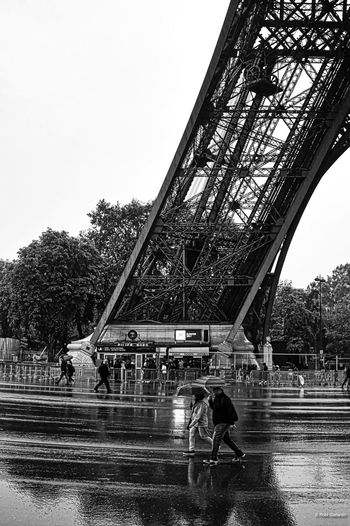 Eiffel Tower in the rain DSLR Eiffel Tower Paris Rainy Days Architecture Black And White Photography Blackandwhite Bnw Built Structure Dlsr Photography Pentax Pentax K-3 Real People Umbrella Walking