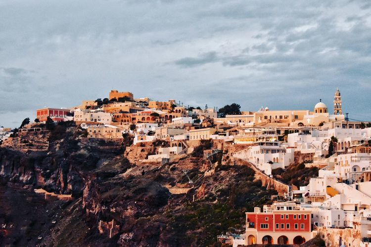 High angle view of buildings in city. fira, santorini