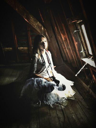 Young woman sitting on hardwood floor