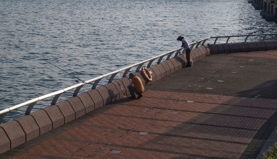 Water Railing Sea Day Outdoors Rippled Nature No People Fishing Pole Fisher Man