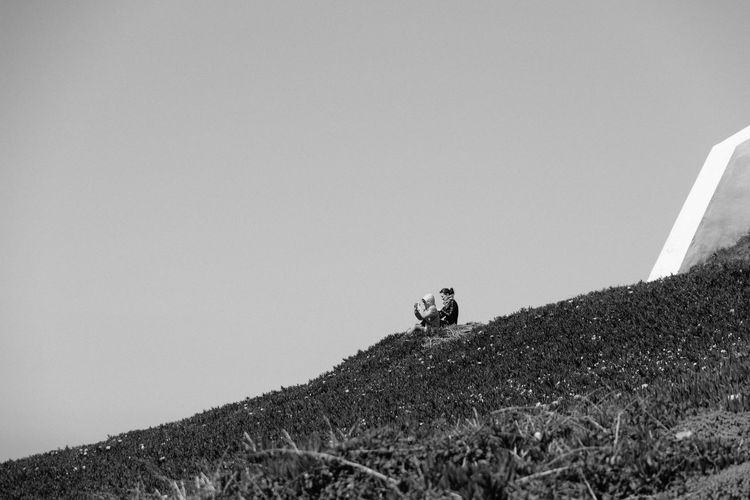Pictures of Cabo da Roca Cabo Da Roca Clear Sky Day Grass Nature Outdoors Photo Plants Portugal Sintra Sintra (Portugal) Sitting Sitting Outside Sky Slope Taking Photos Taking Pictures Two People Windy