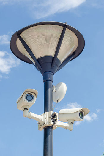 Street security CCTV camera Camera Light Cctv Cloud - Sky Control Digital Camera Electrical Equipment Electricity  Equipment Lamp Lens Low Angle View Outdoors Pole Private Protection Safety Security System Sky Spy Cat Is Spying Technology Warning