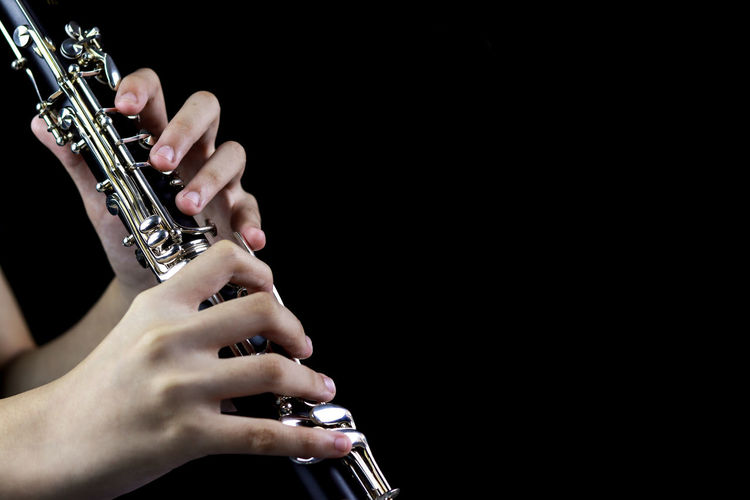 Music Instrument Clarinet Player, Clarinet Player Isolated on black Music Musical Instrument Arts Culture And Entertainment Playing Musician Human Hand Wind Instrument Musical Equipment Holding Artist Studio Shot One Person Indoors  Hand Performance Black Background Human Body Part Skill  Real People Finger