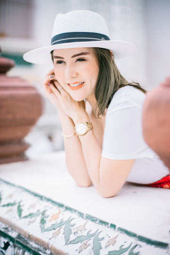 Fashion Adult Beautiful Woman Beauty Clothing Editorial  Focus On Foreground Girl Hairstyle Happiness Hat Headshot Leisure Activity Lifestyles Model One Person Portrait Real People Smiling Sun Hat Watch Women women around the world Women Portraits Young Women