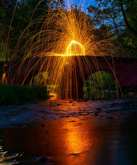 Fire-Orb Nightphotography Orb Bridge Bridge - Man Made Structure Glowing Illuminated Long Exposure Motion Nature Night Outdoors Reflection River Steelwool Steelwoolphotography Water Waterfront Wire Wool