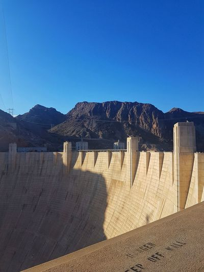 Hoover dam PhonePhotography Samsungphotography EyeEmSelect Eyeemphotography Outdoor Photography Manmadestructures Wonderful USA Manmade Water Dam Beach Desert Mountain City Sand Sand Dune Arid Climate Shadow Sky Landscape Hydroelectric Power Reservoir Rushing Calm Depression - Land Feature Horizon Over Water