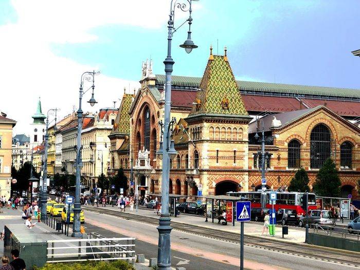 A street scene in Budapest. Street Architecture Building Exterior Built Structure Sky City Street Group Of People Building Road City Life