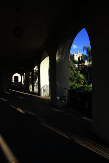 Street seen through arch window of building