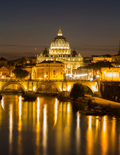 Illuminated St. Peter's Basilica and reflections in the Tiber River after sunset in Rome, Italy Architecture Built Structure Night Illuminated Sky City Travel Destinations Building Tourism Outdoors No People Dome Reflection Italy Vatican Basilica Basilica Di San Pietro In Vaticano San Pietro St Peters Basilica Peter Pope Rome Long Exposure Copy Space