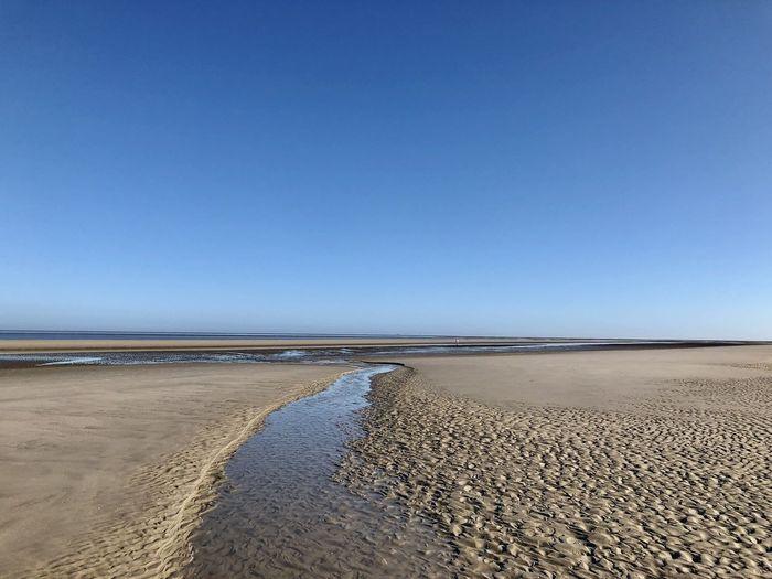View on beach against sky