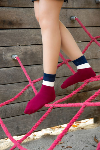 Human Leg One Person Low Section Human Body Part Body Part Real People Shoe Day Red Women Lifestyles Child Sock Human Foot Adult Leisure Activity Fashion Outdoors Childhood Human Limb