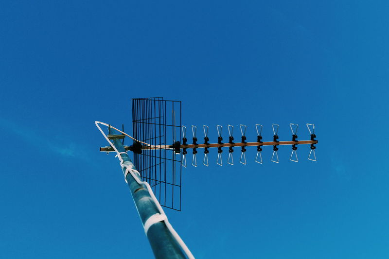 Blue Sky Blue Taking Photos Take Photos Like EyeEmNewHere Clear Sky Technology Antenna - Aerial Sky Television Aerial Antenna Electricity Tower Electric Pole Satellite Dish Telecommunications Equipment Rooftop Tiled Roof  Butterfly Shell Gastropod Perching Speaker Sparrow Parallel Electricity Pylon Megaphone