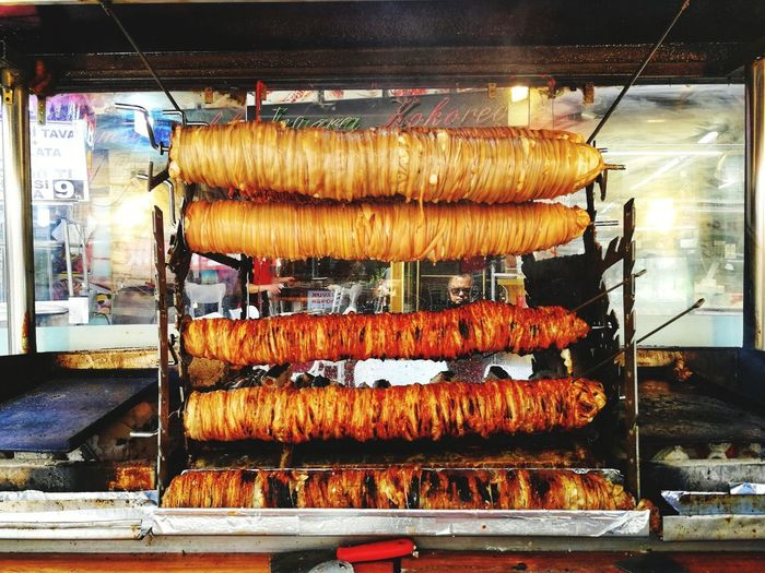Kokoreç is basically lamb intestines, wrapped around sweetbreads on skewer and grilled horizontally over the charcoal fire. Kokoreç Turkish Street Food Street Food Ulus Hali Meat Barbecue Roasted Food And Drink Close-up Stall Display Various