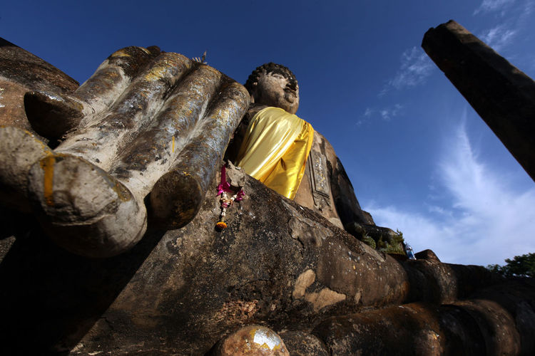 Low Angle View Of Large Buddha Statue