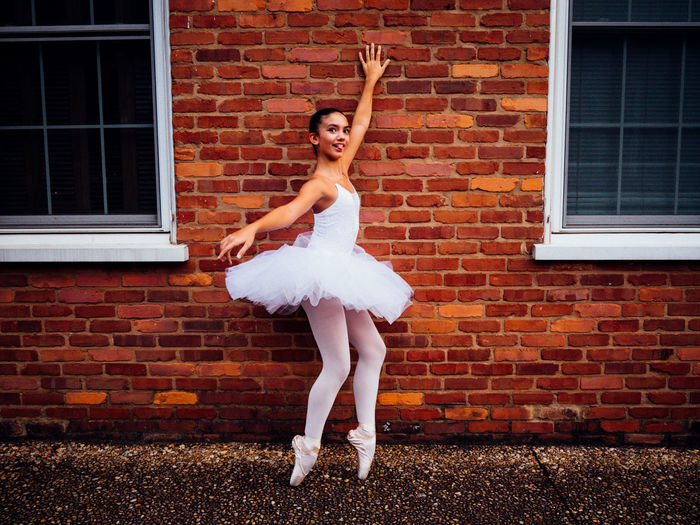 Ballerina Ballet Childhood Looking At Camera Pointe Shoes Portrait Real People Silly Face Smiling Standing Young Adult Young Women Showcase March