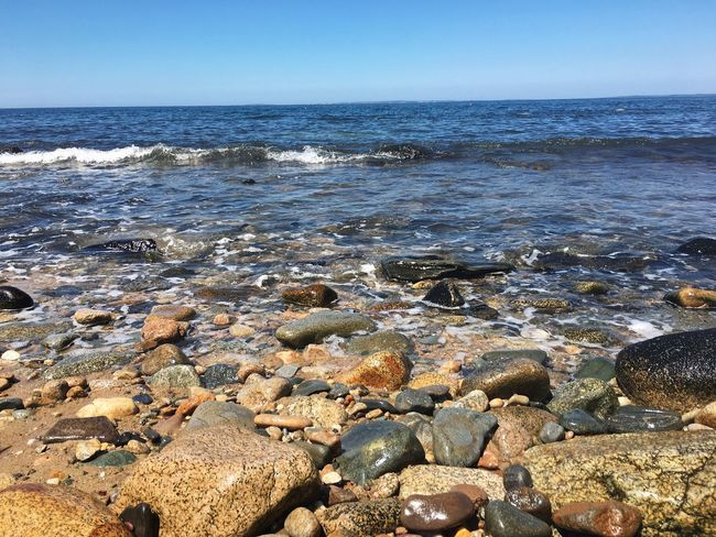 Rocks The Week On Eyem Pebble Beach Sea Water Rock - Object Nature No People Beauty In Nature Beach Scenics Outdoors Day Tranquil Scene Tranquility Horizon Over Water Wave Clear Sky Sky Close-up Pebble Beach