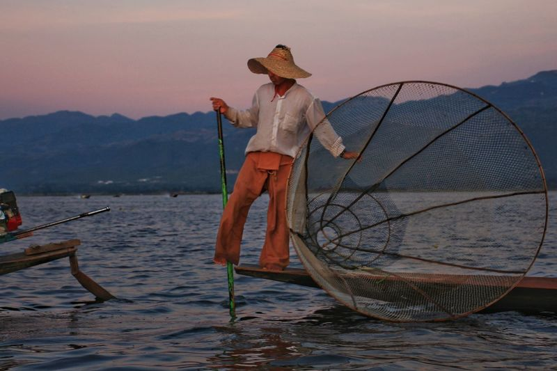 Fishermen at Inle Lake, shan state Myanmar. Twilight Shan State Dramastic ASIA Lifestyle Lifestyle People One Person Real People Showing Working Scenery Naturephotography Lakeview Dusk Photography Inle Lake Intha Adult Adults Only Outdoors Water Nautical Vessel Full Length Beauty Fisherman Lake Occupation Fishing Net Fishing