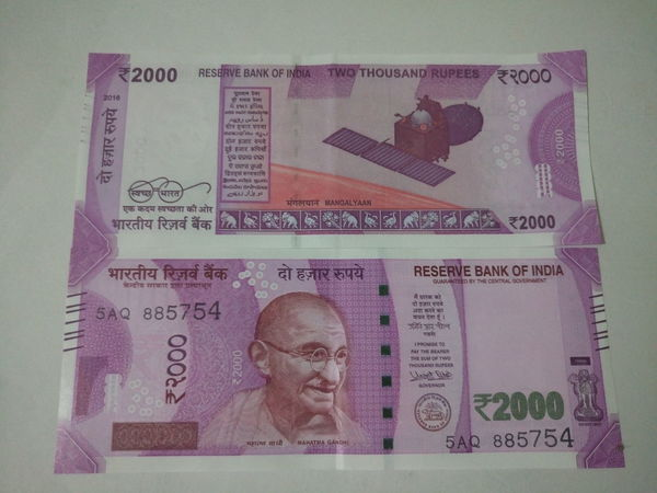 Indian two thousand rupee note 2000 Adult Adults Only Banknote Business Currency Currency Indian Finance Finance And Economy Indian Culture  Indian Currency Indian Two Thousand Rupee Note Men New One Man Only One Person Only Men Paper Currency People Pink Color Savings Success Text Two Thousand Rupee Note Wealth