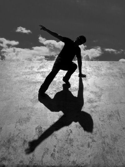 Low Angle View Of Silhouette Man At Skateboard Park